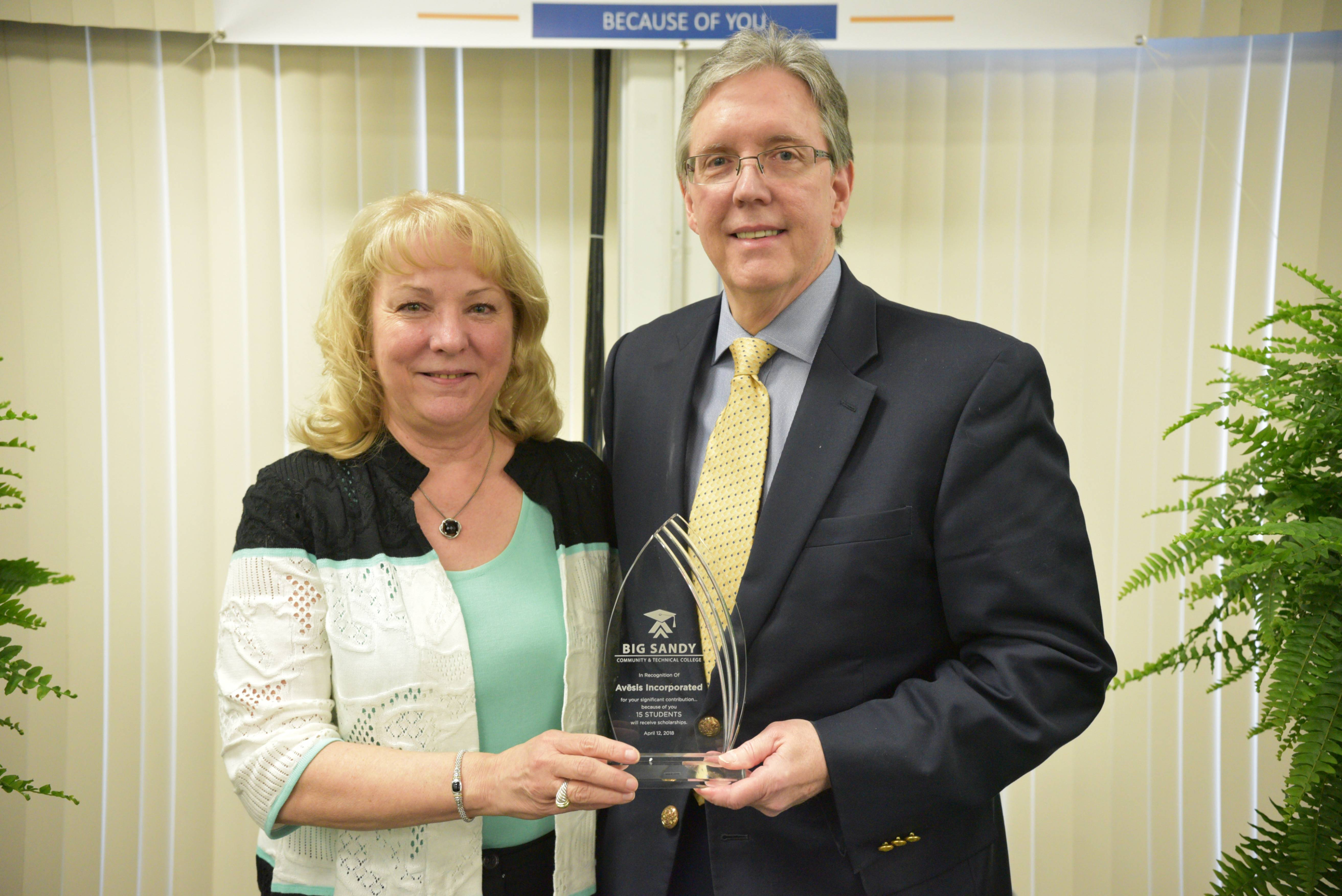 Dr. Andy Elliott DMD, accepts an award on behalf of Avesis from Dr. Sherry Zylka, BSCTC President/CEO at the Celebration of Success. This annual event is held by Big Sandy Community and Technical College to honor donors and their contributions to the college and student success.